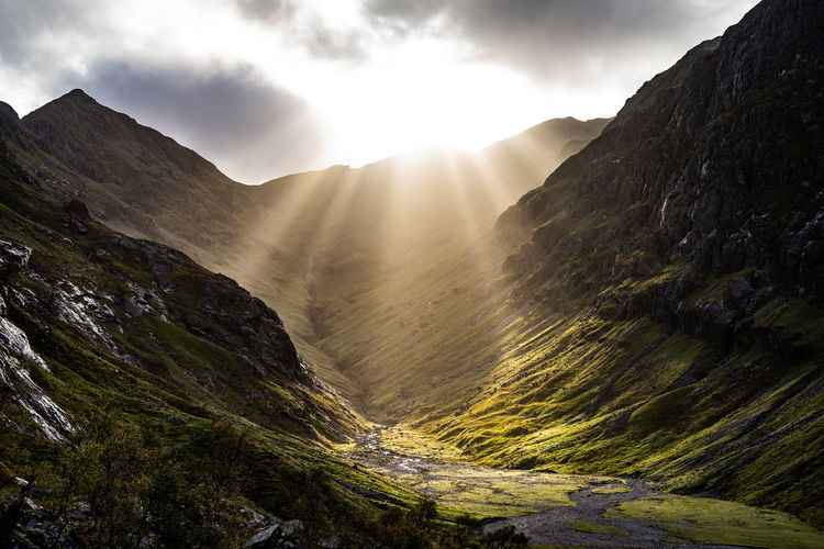 Lost valley in Glen Coe Scotland Scotland Highlands Scotlandsbeauty Glencoe Glencoe Scotland Mountain Sunlight Tree Sky Cloud - Sky Landscape Shining Sunbeam Dramatic Sky Sun Foggy Mountain Range Atmospheric Mood Moody Sky Romantic Sky Mountain Peak