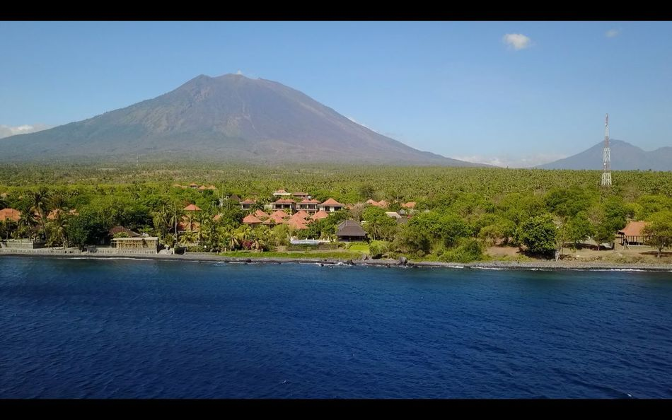 Lost In The Landscape Mountain Scenics Water No People Nature Tranquil Scene Tranquility Beauty In Nature Outdoors Day Landscape Idyllic Waterfront Architecture Blue Clear Sky Built Structure Sky Tree Mountain Range in Tulamben Bali, Indonesia