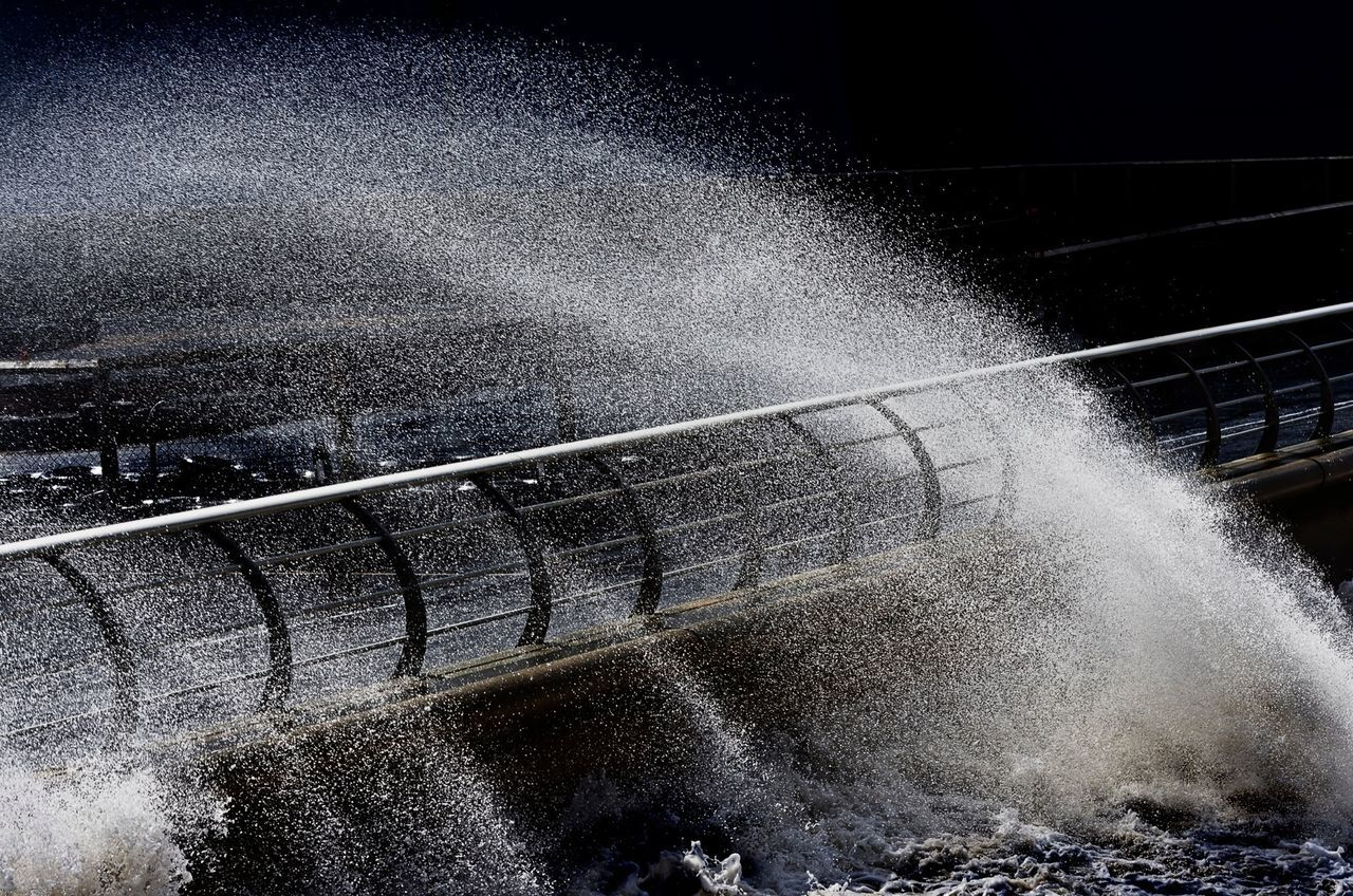 Water splashing on railing