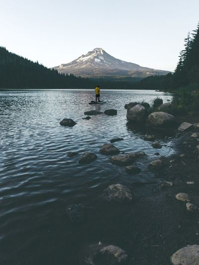 Lonely Paddle Mt Hood Trillium Lake Outdoors Road Trip Travel Oregon Pacific Northwest  Water Sky Mountain Real People Day Nature Beauty In Nature Clear Sky Waterfront Scenics - Nature Non-urban Scene One Person Lifestyles Outdoors Tranquility Lake Leisure Activity Tranquil Scene Men
