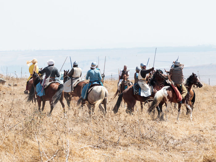 Tiberias, Israel, July 01, 2017 : Participants in the reconstruction of Horns of Hattin battle in 1187 participate in the battle on horseback on the battlefield near Tiberias, Israel Battle Cross Crusaders Field Fire Guy De Lusignan Hattin Heat Heritage History Horn Horseman Infantry Israel Jerusalem KINGDOM Knight  Muslims Palestine Religion Saladin Templars Victory War Weapons