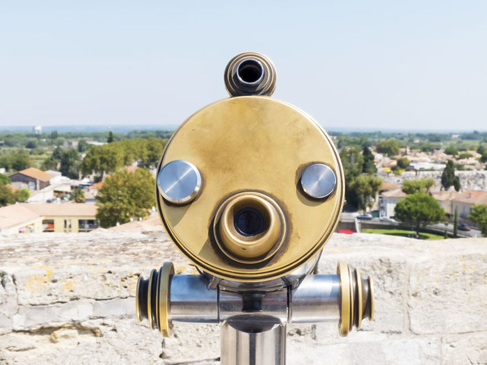 Close-Up Of Coin-Operated Binoculars Against Sky In City