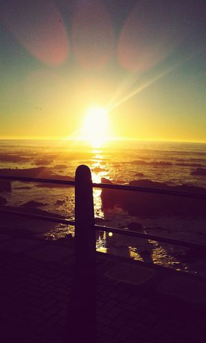 Sunset Sea Water Reflection Nature Sky Outdoors Horizon Over Water No People Day Coastal Feature Sea Point Cape Town Travel Destinations Beach Tranquil Scene Wave Sun Nature
