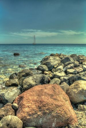 Sailing Sea Water Horizon Over Water Rock - Object Sky Beach Nature Tranquility Beauty In Nature Tranquil Scene Scenics Outdoors No People Day Pebble Pebble Beach Hdr_Collection Landscape Travel Destinations HDR