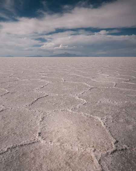 Salar De Uyuni Cloud - Sky Sky Tranquil Scene Tranquility Scenics - Nature Salt Flat Environment Mineral Beauty In Nature Nature Landscape No People Day Horizon Horizon Over Land Desert Non-urban Scene Land Salt Lake Outdoors Arid Climate Climate