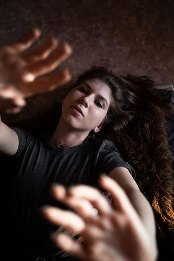 Portrait of woman lying on rug