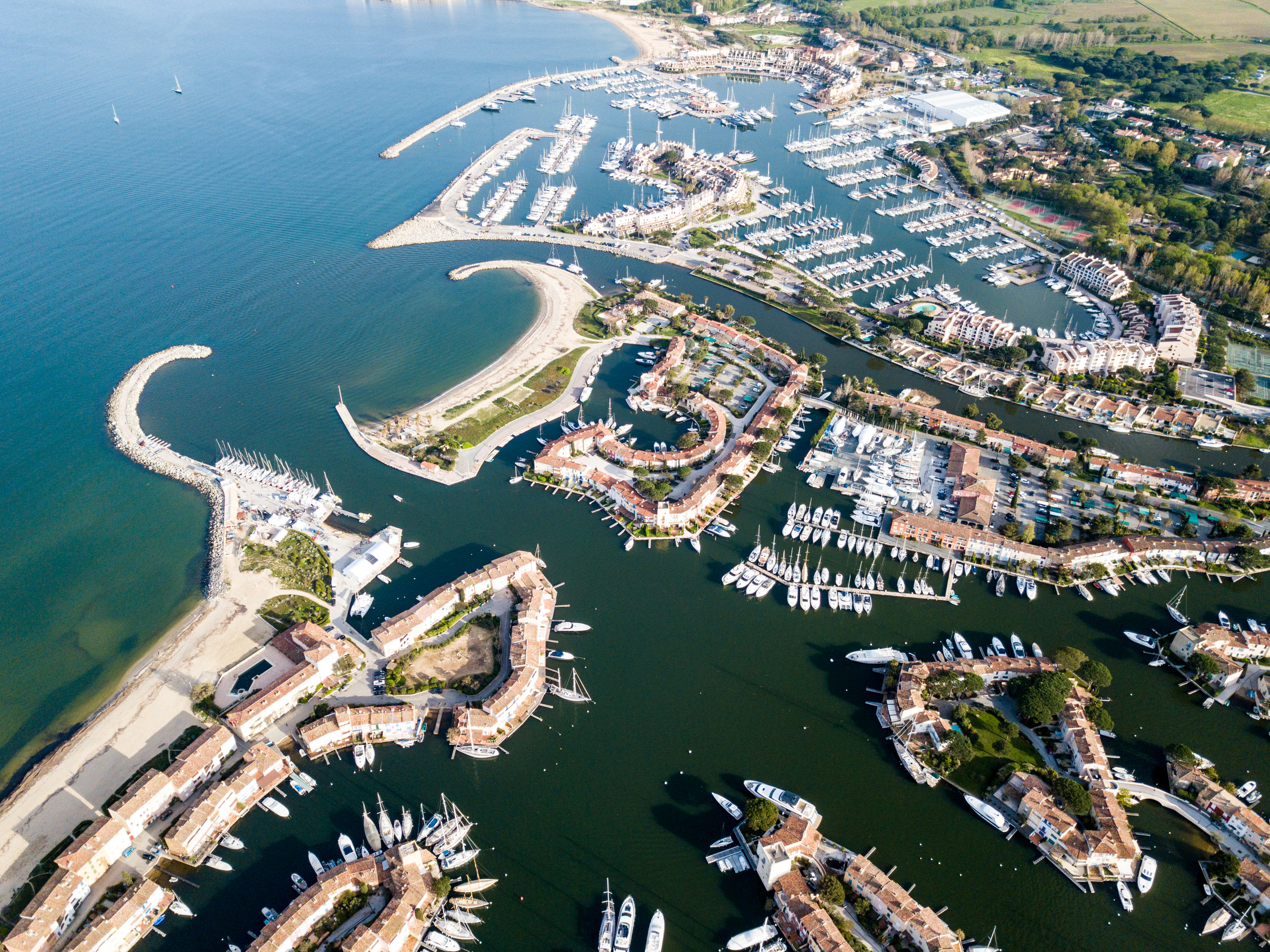 aerial view, water, high angle view, nature, building exterior, architecture, sea, day, built structure, transportation, scenics - nature, city, no people, beauty in nature, cityscape, outdoors, nautical vessel, land, beach, bay