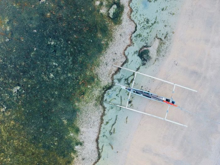 Coastline Aerial View Aquatic Sport Beach Beauty In Nature Boat Day High Angle View Incidental People Land Leisure Activity Men Nature Outdoors People Real People Reflection Sea Sport Water Waterfront The Great Outdoors - 2018 EyeEm Awards The Traveler - 2018 EyeEm Awards Capture Tomorrow 2018 In One Photograph
