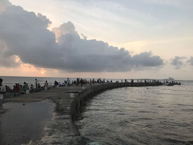 Sea Water Sky Large Group Of People Beach Nature Real People Scenics Cloud - Sky Beauty In Nature Vacations Sunset Tranquility Men Outdoors Horizon Over Water Lifestyles Day People
