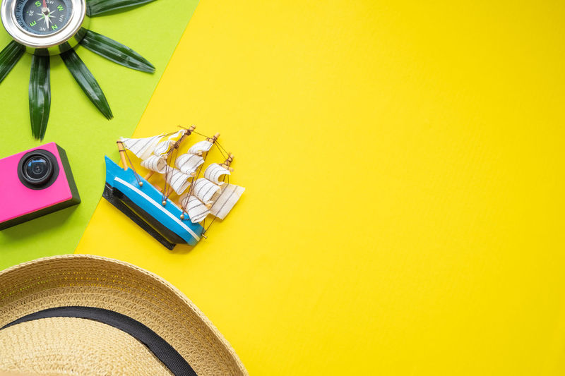 Camera Green Hat Holiday Office Stylish Traveling Color Colorful Compass Copy Space Guide High Angle View Leaf Leaves Mock Up Paper Sail Sailboat Straw Studio Shot Style Table Yawl Yellow