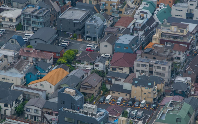 High angle view of street amidst houses in town