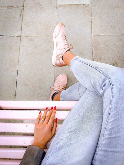 Hand and legs Legs Crossed At Knee Sitting Casual Clothing Sneakers Pink Fashion Human Body Part Body Part Women Low Section Personal Perspective Human Leg Real People Nail Polish Human Limb Nail Directly Above