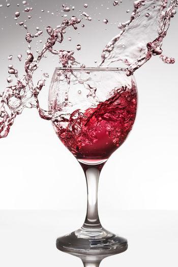 Winesplash Alcohol Close-up Drink Food And Drink Freshness Glass Motion No People Red Refreshment Splash Studio Shot Tabletop Tabletopphotography White Background Wine Winesplash