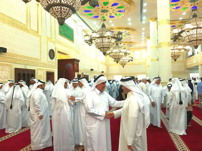 Eid Mubarak. After Eid Prayer people wishing each other rReligionsSpiritualityhHangingiIndoors mMendDaypPeopleaLarge Group Of People Adult Arabic Culture Arabic Qatar Days