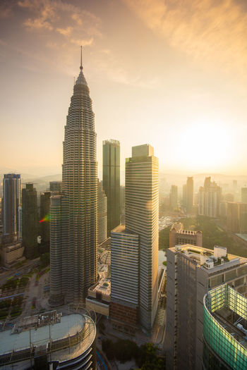 Kuala Lumpur skyline sunrise Building Exterior Built Structure Architecture City Office Building Exterior Building Skyscraper Cityscape Sky Tower Modern Tall - High Travel Destinations Nature Office Urban Skyline No People City Life High Angle View Outdoors Financial District  Spire