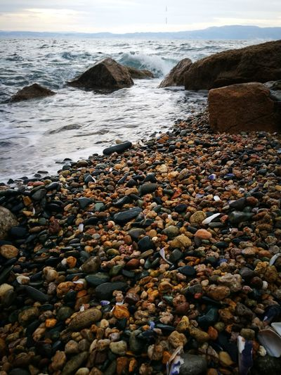 Justphotography NoFilterNoEdition Huaweiphotography No Filter No Filter Just Nature<3 Just Nature HuaweiP9Photography Beach Stones Beach Shore Sea Pebble Water Pebble Beach Nature Horizon Over Water Rock - Object Day Beauty In Nature Sand No People Outdoors Sky Close-up