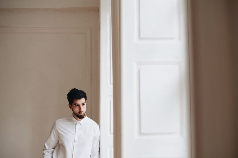 Groom standing by door