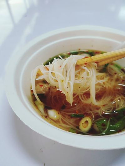 White noodle with spicy soup lift up by chopstick White Noodle Thai Noodle Cooked Bamboo Lunch Time Daylight Meal Set On The Go  EyeEm Selects Bowl Soup Close-up Food And Drink Vegetable Soup Noodles Served Chopsticks Soup Bowl Noodle Soup Sauce Prepared Food