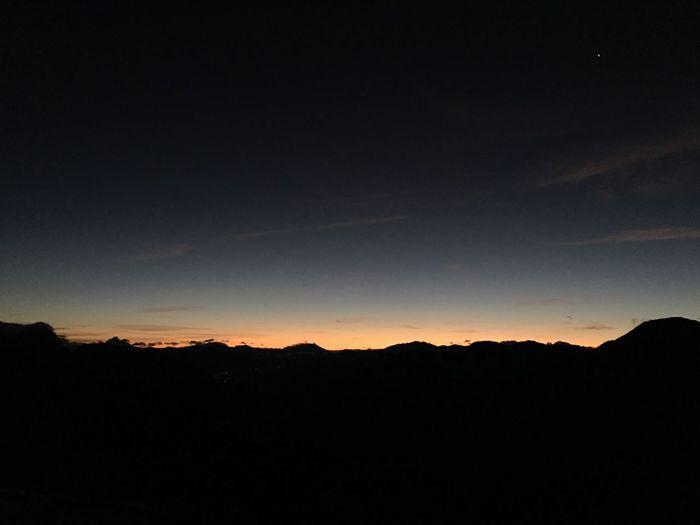 黎明將至 Sky Silhouette Beauty In Nature Tranquil Scene Scenics - Nature Tranquility Sunset Tree Dark Star - Space Outdoors Mountain No People Night Landscape Nature