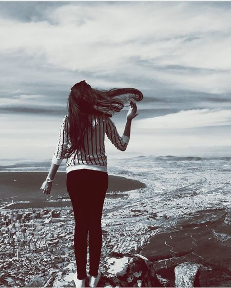 One Woman Only Only Women One Person Adults Only Long Hair Standing One Young Woman Only Adult Rear View People Women Young Adult Cloud - Sky Sea Sky Outdoors Beach Water Day Sea And Sky Wind Vision