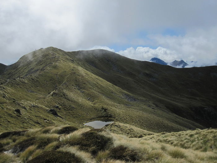 Mountain Scenics - Nature Sky Cloud - Sky Environment Landscape Beauty In Nature Tranquil Scene Tranquility Non-urban Scene No People Day Nature Mountain Range Land Grass Plant Idyllic Remote Outdoors Mountain Peak Rolling Landscape New Zealand Kepler Track
