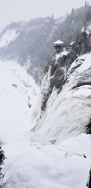 Waterfall Frozen Mountain Snow Cold Temperature Winter Snowcapped Mountain Fog Tree Polar Climate Frozen Landscape Pine Woodland Evergreen Tree Flowing Water