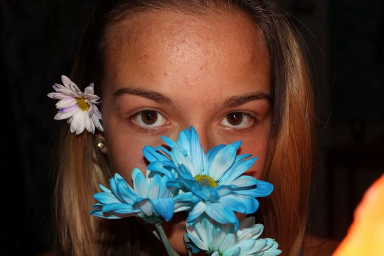 EyeEm Selects Flower Portrait Looking At Camera One Person Petal Springtime Flower Head One Young Woman Only Beautiful Woman Only Women Beauty Young Adult Young Women Beautiful People Close-up Nature