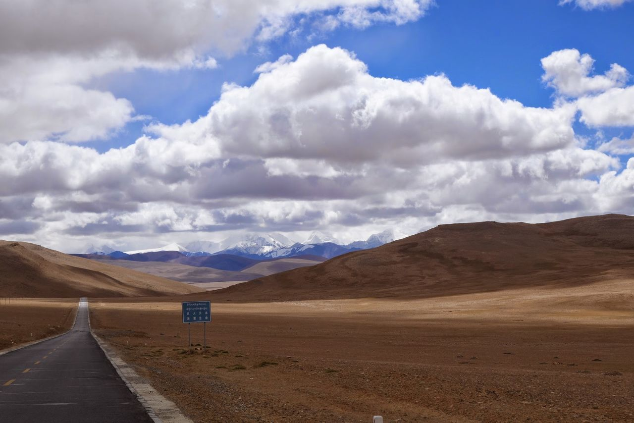 cloud - sky, sky, scenics, road, landscape, nature, tranquility, tranquil scene, beauty in nature, mountain, day, no people, the way forward, outdoors, mountain range, desert
