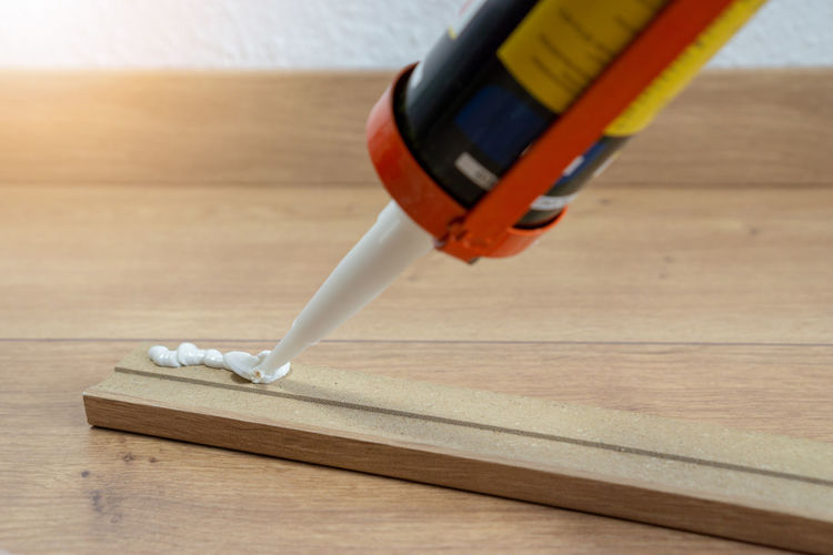 High angle view of paintbrushes on wooden table