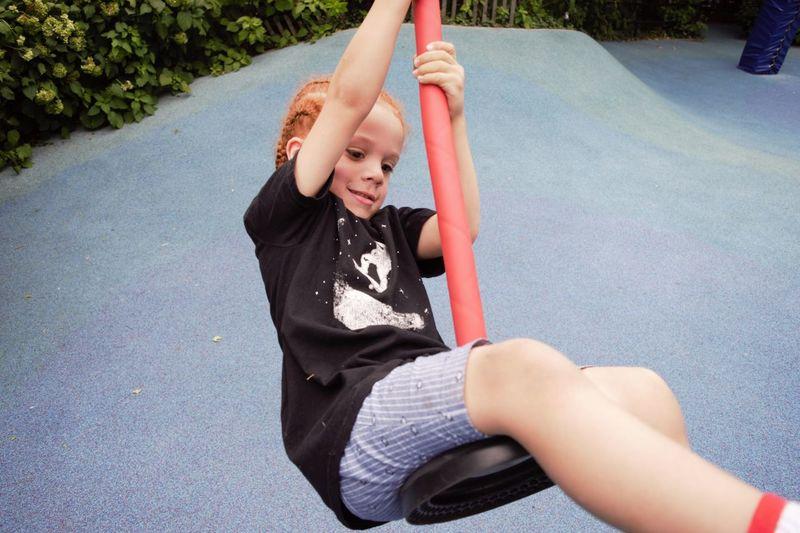 Cute girl swinging at park