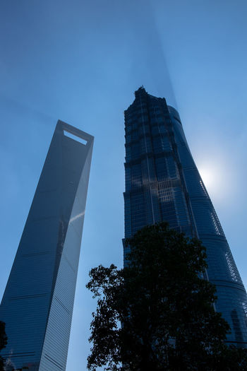 China Shanghai Buildings Architecture Building Exterior City Financial District  Sky Shadows Pudong Skyline JinMaoBuilding Sunbehindbuilding Bottle Opener Shanghai World Financial Center Financial District  Finance Economy Deal With It Affair Fujifilm