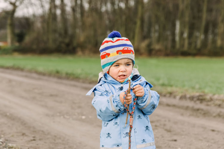 Full length of cute baby girl standing on land