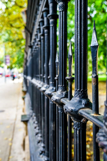 old rusty fence Fence People Sidewalk Water Metal Protection Gate Safety Close-up Architecture Building Exterior Wrought Iron Iron - Metal Metalwork
