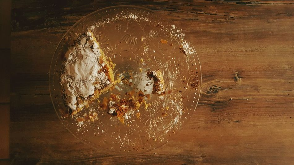 No People Still Life Cake Table Kitchen Kitchen Utensils Wooden Wooden Table Glass Glass Plate Glass - Material Brown Delicate High Angle View Crumbs Crumble Powdered Sugar Sugar Food Remaining Sweet Sweet Food Food Stories