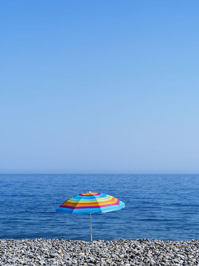 Sougia beach on the south side of Crete Beach Blue Clear Sky Holiday Horizon Over Water Minimalism Multi Colored Pebble Beach Relaxation Sea Summer Tranquil Scene Tranquility Umbrella Vacations Water