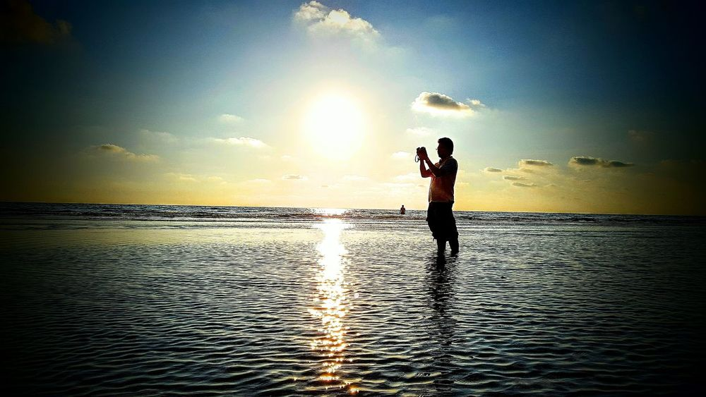Sunset Sea Reflection Sunlight Horizon Over Water Silhouette Sky Sport Beauty In Nature One Person Beach Water Sunbeam Outdoors Nature Adult Adults Only Sun People Men