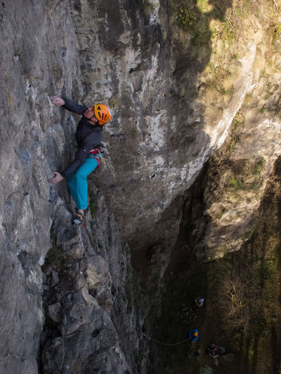 Julius Zonneveld enjoying a nice sport climbing route on a cold day in february Belgium Climber Activity Adventourus Adventure Challenge Climbing Extreme Sports Helmet Mountain One Person Outdoors People RISK Rock Climber Rock Climbing Rope Sport Sport Climbing Strong