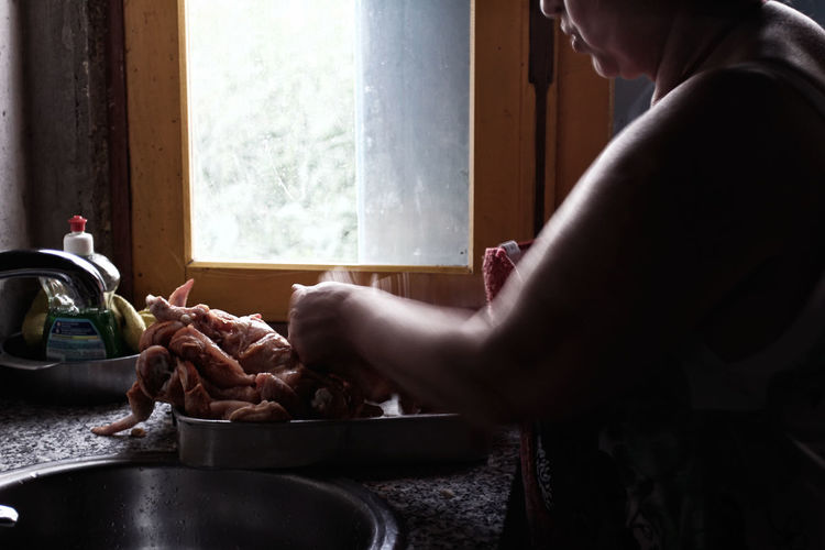 Chicken Cooking Cooking At Home Dim Light Domestic Kitchen Freshness Kitchen Lifestyles Portugal Preparation  Woman