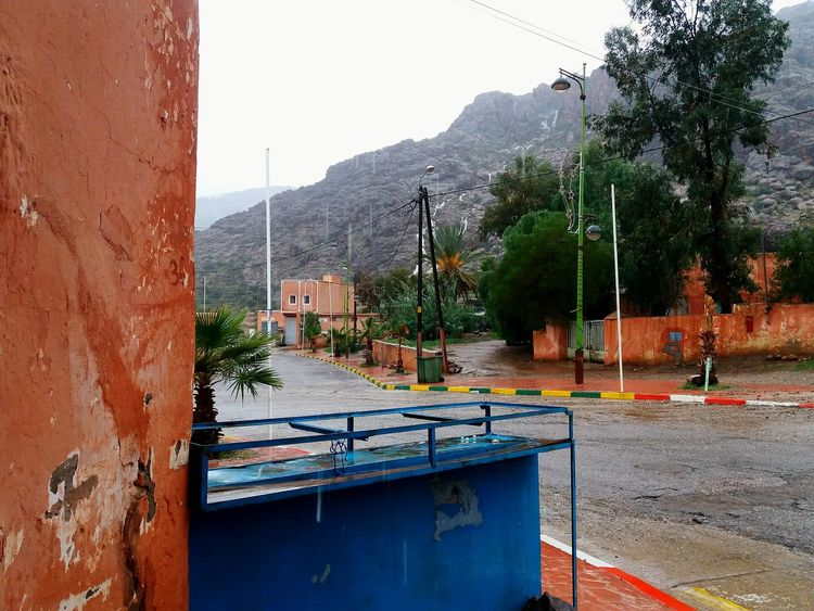 Rain in the mountains Antiatlas Antiatlasmountains Atlasmountains Idaougnidif EyeEm Selects Tree Water Mountain Sky Building Exterior Architecture Built Structure Residential Structure Garden Hose Fountain Watering Watering Can TOWNSCAPE Exterior