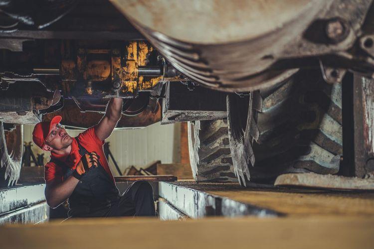 Mechanic working at garage