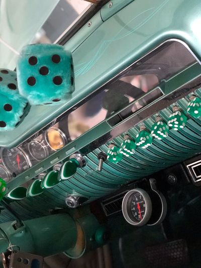 DICE MOBILE Original Interior Decoration Hanging Dice Dice Controller Knobs No People Close-up High Angle View Technology Green Color Still Life Motor Vehicle Car Vehicle Interior Transportation Car Interior Equipment