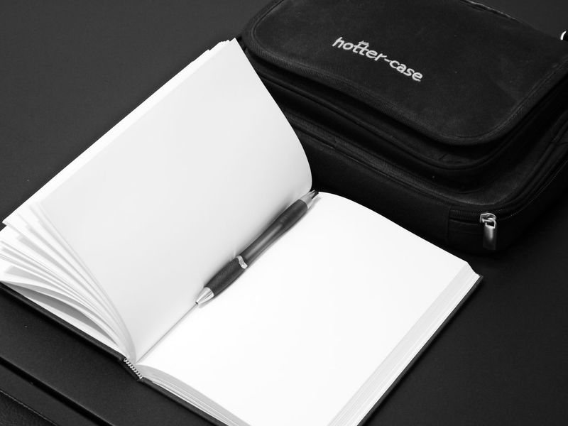 Blank Book Close-up Communication Day Diary Education High Angle View Indoors  Laptop Bag No People Note Pad Page Paper Still Life Table Technology Text