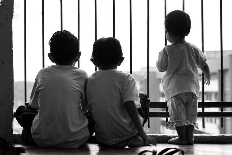 Child Men Boys Standing Sitting Politics And Government Friendship Rear View Togetherness Single Parent School Uniform Children Caucasian Elementary Student Looking Through Window