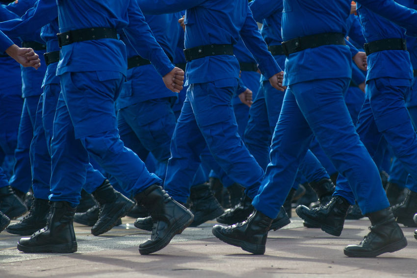 Armed Forces Army Soldier Blue Celebration Clothing Crowd Day Event Government Group Of People In A Row Large Group Of People Low Section Men Military Outdoors Real People Responsibility Security Togetherness Uniform