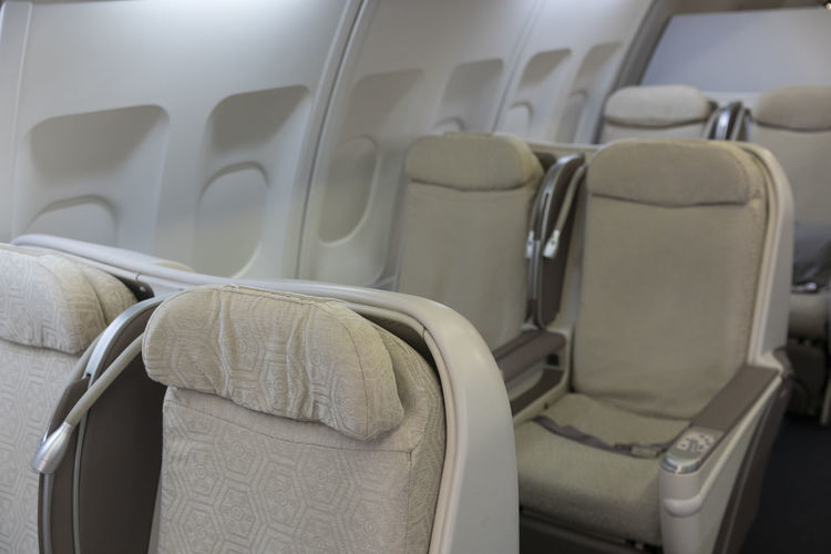 Seat Vehicle Interior Vehicle Seat Transportation Absence Empty Travel Mode Of Transportation Air Vehicle Airplane No People Indoors  Chair Public Transportation In A Row Journey Window Airplane Seat Close-up Luxury