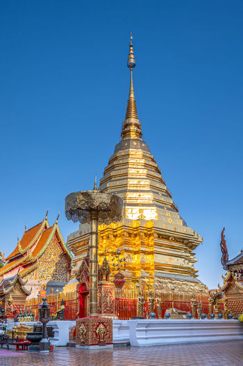 Low angle view of pagoda against clear blue sky