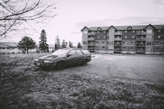 Abandoned Abandoned Car Apartment Black And White Composition Grass Land Vehicle Old Outdoors Parked Parking Lot Rusted Car