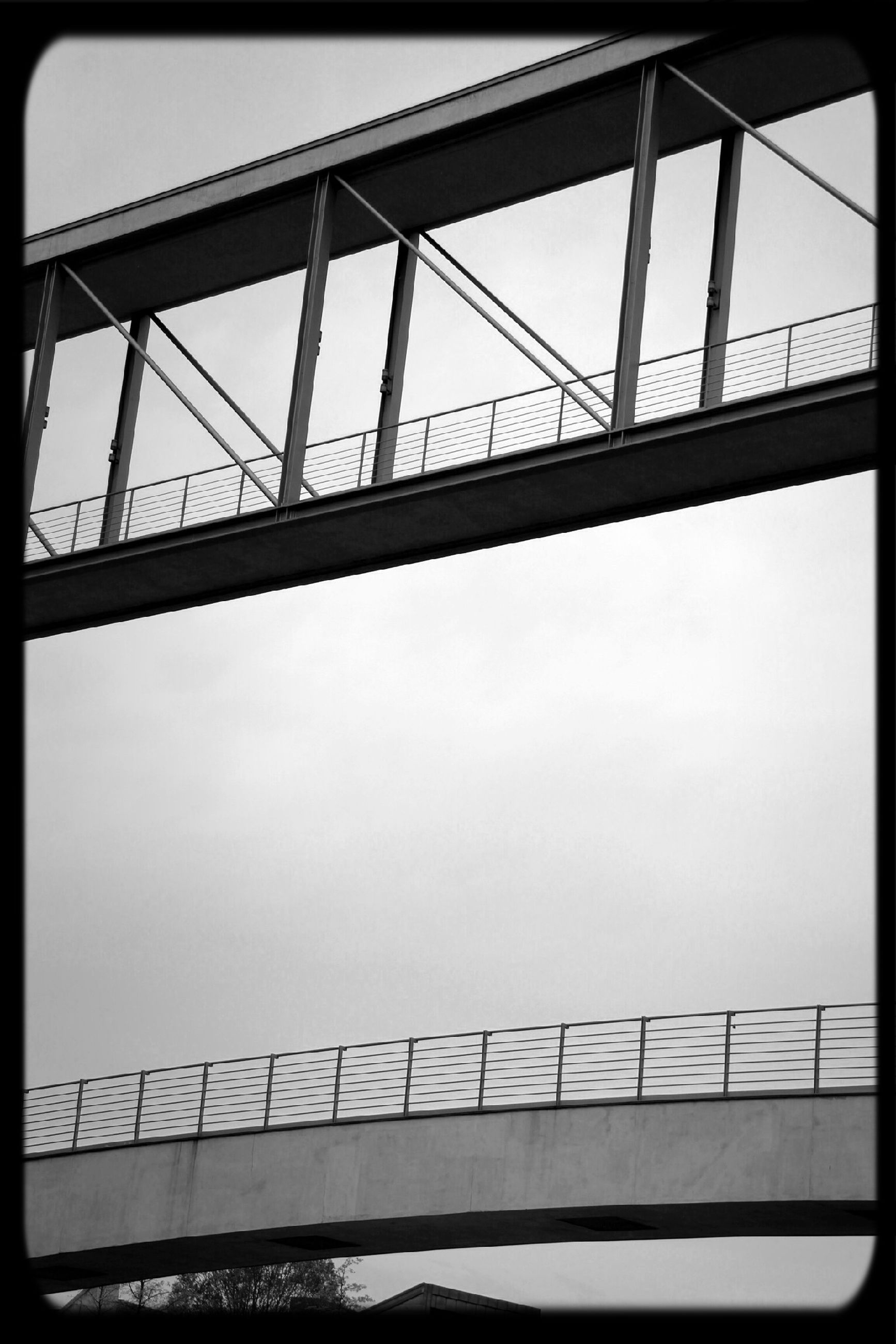 railing, metal, connection, bridge - man made structure, built structure, sky, architecture, low angle view, metallic, transfer print, engineering, auto post production filter, day, no people, bridge, outdoors, transportation, fence, cloud - sky, sunlight