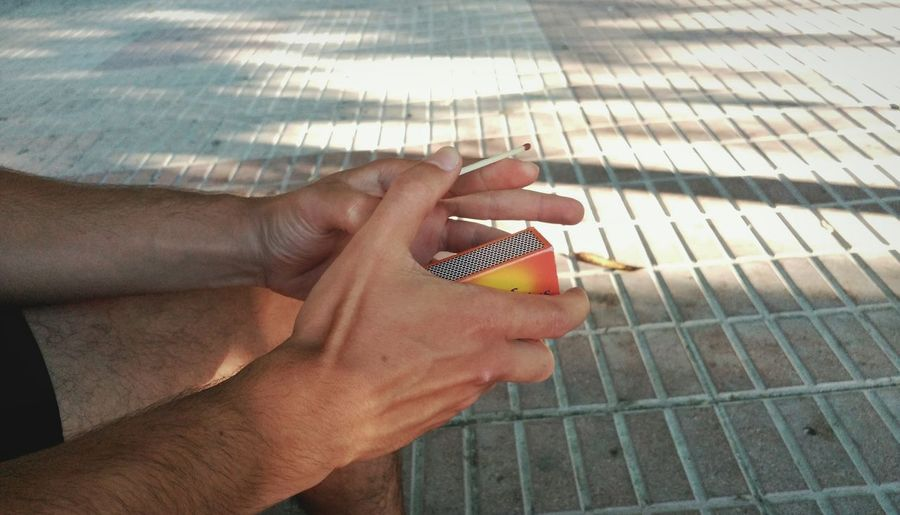 Midsection View Of Man Holding Matchbox