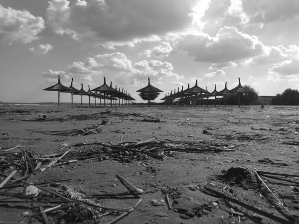 Beach Sea Sand Sky Shore Cloud - Sky Nature No People Beauty In Nature Umbrellas Sadness Forbidden Places Abandoned Monochrome Photography Your Ticket To Europe Breathing Space The Week On EyeEm Black And White Friday